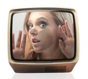 Schönheit eingeschlossen im Fernsehapparat Stockbild
