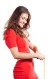 Schönheit glücklich beim Messen ihrer Taille stockbild