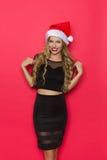 Schönheit im schwarzem Kleid und in Santa Hat Stockbild
