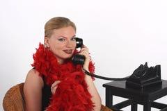 Schönheit mit einem Retro- Telefon auf weißem Hintergrundisolator Lizenzfreies Stockfoto