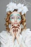 Schönheit mit Winterartmake-up lizenzfreies stockfoto