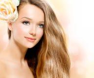 Schönheits-Mädchen mit Rose Lizenzfreies Stockbild