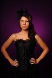 Schönheitsfrau im schwarzen Korsett lizenzfreie stockbilder
