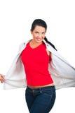 Schönheitsfrau im unbelegten roten T-Shirt und in den Jeans Stockbild