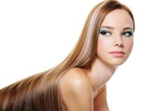 Schönheitsfrau mit dem lang glatten luxuriösen Haar Stockfotografie