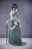 Schönheitsfrau mit gehendem Steuerknüppel Stockfotos