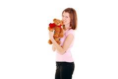 Schönheitsfrauen-Holding-Teddybär. stockfotos