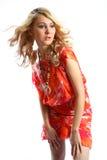 Schönheitsmädchen im orange Kleid Lizenzfreies Stockbild