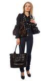 Schönheitsmädchen mit Handtasche drei lizenzfreies stockfoto