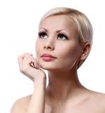 Schönheitsmädchen. Schönes Gesicht lokalisiert auf weißem Hintergrund. Hautpflege Lizenzfreie Stockbilder