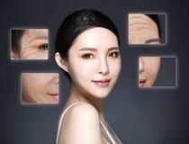Schönheitsporträt der Frau mit ihrem alten Gesichtsfoto stockbild