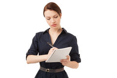 Schönheitssekretär, der Kenntnisse in einem Notizbuch nimmt Stockfotos