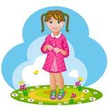 Schüchternes kleines Mädchen mit Zöpfen Stockfoto