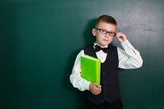 Schüler auf Klassenzimmerbrett Lizenzfreie Stockfotos