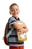 Schüler mit Büchern und Rucksack stockfotografie