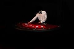 Schürhakenspieler mit Karten Stockfotos