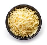 Schüssel geriebener Käse von oben Stockbild