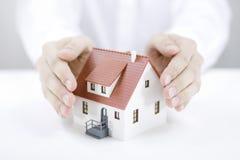 Schützen Sie Ihr Haus Stockbild