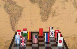 Schaakbord met vlaggen van landen Stock Fotografie