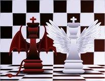Schach-Königengel und -teufel Stockfoto