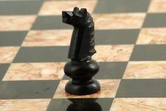 Schach-Stück, schwarzer Ritter Stockbild