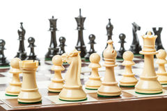 Schachvorstand und -stücke Stockfotos