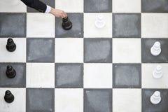 Schachzug im Freien Stockbild