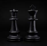 schack Svart konung och drottning Arkivfoton