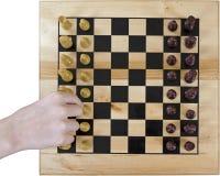 Schackbräde med en hand Arkivbild