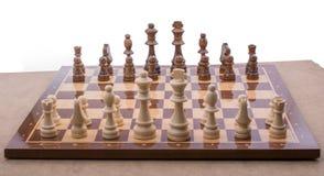 Schackbräde med schackstycken Arkivbild