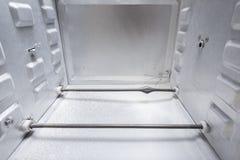 Schade in de oven stock foto's