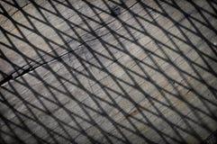 Schaduw en lijn op houten vloer Stock Foto