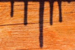 Schaduw in hout stock afbeelding