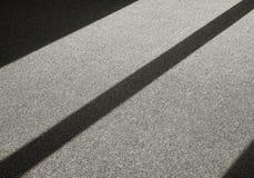 Schaduw op een tapijtvloer Stock Fotografie