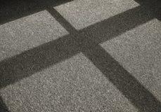 Schaduw op een tapijtvloer Stock Foto's
