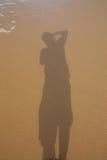 Schaduw op het strand. Stock Foto