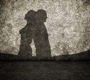 Schaduw van de man en de vrouw op muur Stock Fotografie