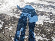 Schaduw van mensen op de sneeuw Stock Afbeeldingen