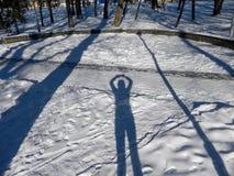 Schaduw van mensen op de sneeuw Royalty-vrije Stock Afbeeldingen