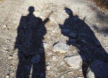 Schaduw van twee bewapende mensen Stock Fotografie
