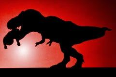 Schaduw van tyrannosaurus die een lichaam op muur in rood bijten Royalty-vrije Stock Afbeelding