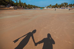 Schaduwen op het strand Royalty-vrije Stock Afbeeldingen