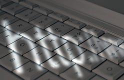 Schaduwen op laptop toetsenbord Stock Afbeeldingen