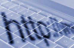 Schaduwen op laptop toetsenbord Stock Fotografie