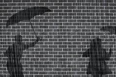 Schaduwen van mensen op muur Stock Foto