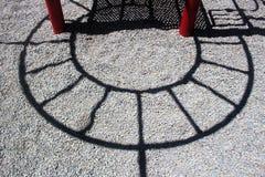 Schaduwhalve cirkel op het Grint Royalty-vrije Stock Foto's