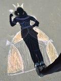 Schaduwprinses op asfalt. Stock Foto