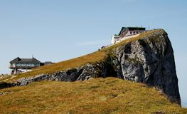 Schafberg Mountain, Austria. This images shows a chalet on the right located on the Schafberg Mountain in Austria, Europe. On the left is a cable car. Sky is Royalty Free Stock Photo