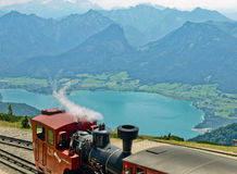 Schafbergbahn. Schafberg railway steam train takes people almoust to the top of mountain Stock Photo