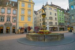 Schaffhausen, SH  / Switzerland - 22 April 2019: historic fountain and square in the old town of Schaffhausen with people milling. About stock images